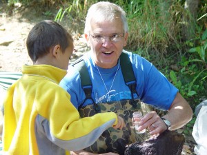 Volunteers collect river creatures.
