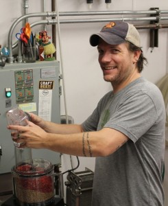 Tim Schmidt, Head Brewer, grinding peppercorns