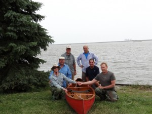 The crew celebrates the completion of their adventure at Pointe Mouillee with the waters of Great Lake Erie behind them