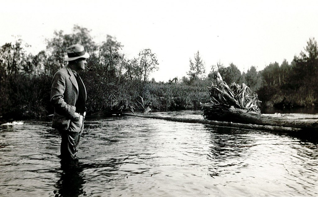 This 1930's fisheries scientist surveys a habitat improvement project. Credit: Institute for Fisheries Research