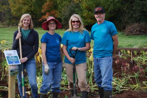 Catie Wytychak, Susan Bryan, Mary Sheaffer-Manthey and Frank Commisky planting a new rain garden at Thurston Elementary