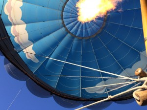 View from the basket, as the burner sends a shot of hot air into the balloon