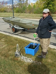 "Stevi with the boat, ponar and ""muck bucket"" for mixing sediment samples"