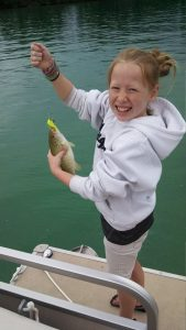 Ally with her first lake fish