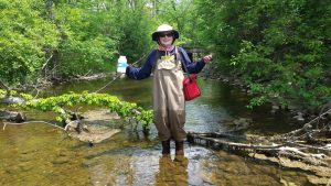 Pat Chargot water quality monitoring on a Huron River creek