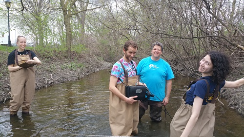 Volunteers Jacinda Bowman, Daniel Tanner, Ron Fadoir, and Charlotte Weinstein at Silver Creek having fun and taking flow measurements.