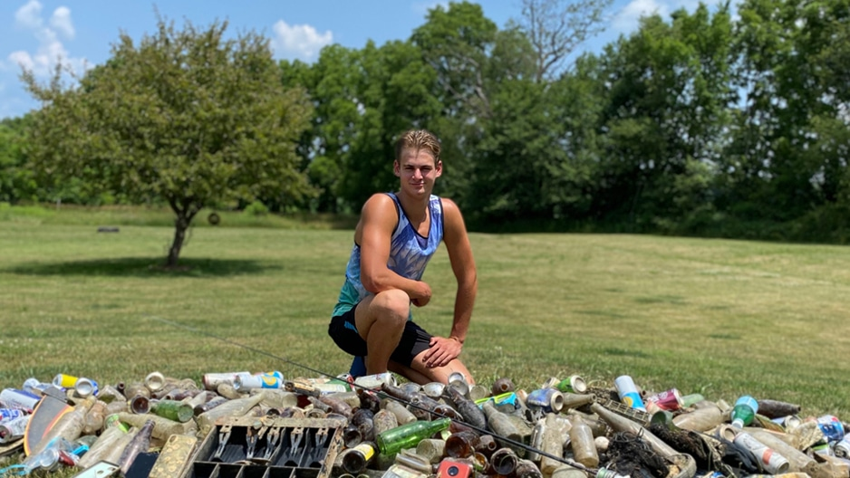 Tony Golin by his collection of trash from the Huron River. Photo courtesy of the Golin Family.