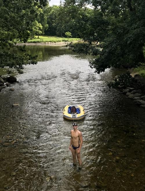 Tony Golin standing in the river at Hudson Mills Metropark