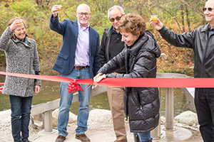 Janis Bobrin cuts the ribbon at Flux + Flow