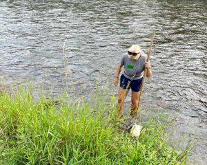 A camper uses a dip net
