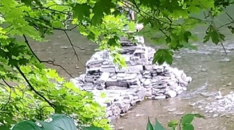 Rock stack that kills aquatic insects