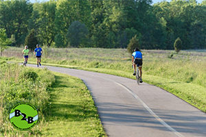 People bike and run on the border-to-border trail